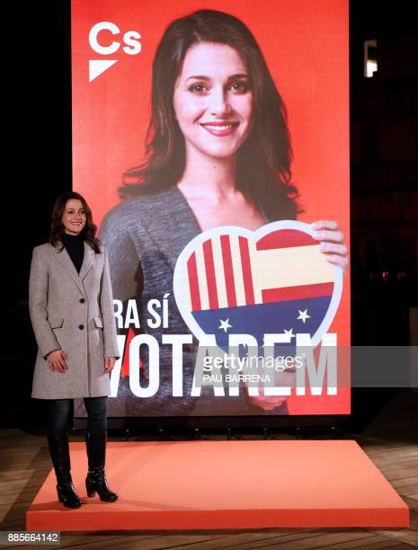 'Ciudadanos' cadidate for the upcoming Catalan regional election Ines Arrimadas poses next to her electoral poster during the campaign opening...