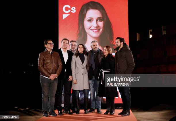 'Ciudadanos' cadidate for the upcoming Catalan regional election Ines Arrimadas poses with other 'Ciudadanos' members next to her electoral poster...