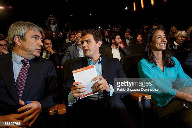 Ciudadanos leader Albert Rivera chats with Spanish economist Luis Garicano as they sit next to Ciudadanos candidate for Madrid Begona Villacis during...