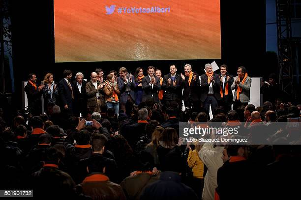Ciudadanos party leader Albert Rivera stands on stage with other members of his party at the en of the final electoral campaign rally at Plaza de...
