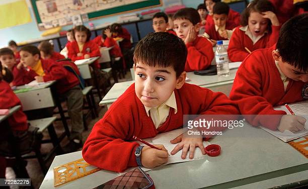 Civan a sixyearold Kurdish boy attentively watches a lesson given in Turkish January 8 2003 in Diyarbakir the capital of Kurdish areas of Turkey...