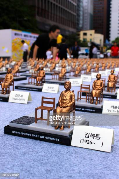 Civic groups display 500 miniature seated statues of a girl representing 'comfort women' in Cheonggye Stream Square on August 14 2017 in Seoul South...