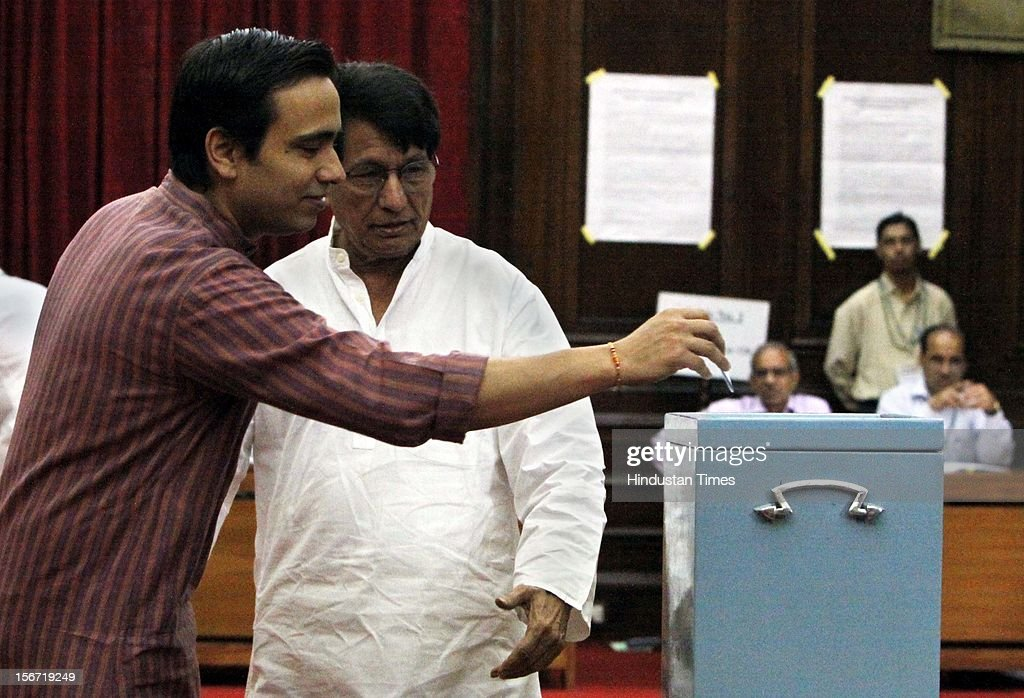 'NEW DELHI, INDIA - AUGUST 7: Civil Aviation minister Ajit Singh and his son Jayant chaudhury casting vote for the election of Vice President at Parliament house on August 7, 2012 in New Delhi, India. (Photo by Sunil Saxena/Hindustan Times via Getty Images)'