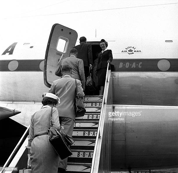 Civil Aviation People Air hostess Irene Mallory welcomes passengers at the top of the steps for a BOAC flight