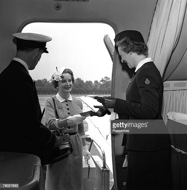Civil Aviation People Air hostess Irene Mallory with a steward welcomes a passenger on board the plane