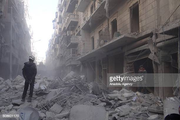A civil defense team member stands on the debris of a building after the war crafts belonging to the Russian army carried out airstrikes on the...