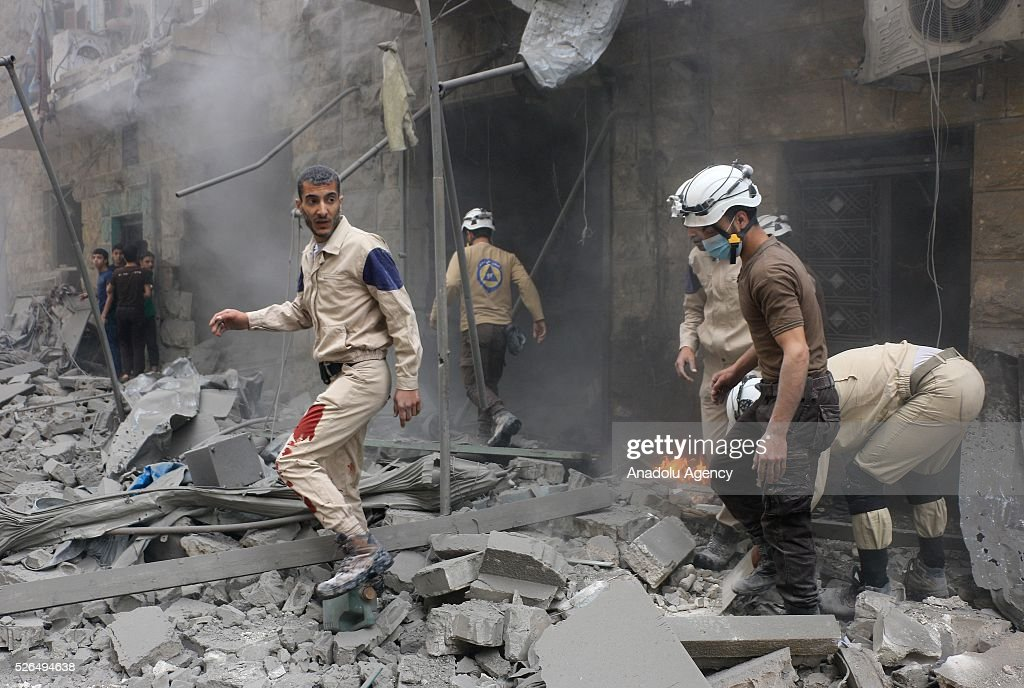 Civil defense workers and civilians carry out search and rescue works after the Russian forces staged air-strikes in Bustan al Qasr Neighborhood of Aleppo, Syria on April 30, 2016.