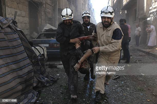 Civil defense workers evacuate dead bodies and woundeds after Assad regime's air strikes on residential areas in Mesekin district of Aleppo in Syria...