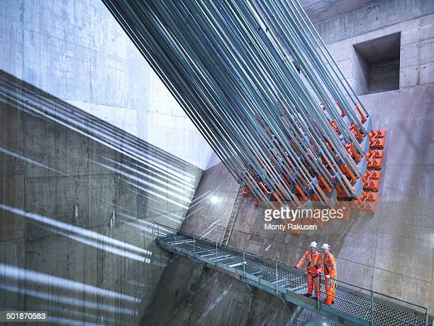 Civil engineers inspecting cable anchorage in suspension bridge. The Humber Bridge, UK, built in 1981 was the world's largest single-span suspension bridge