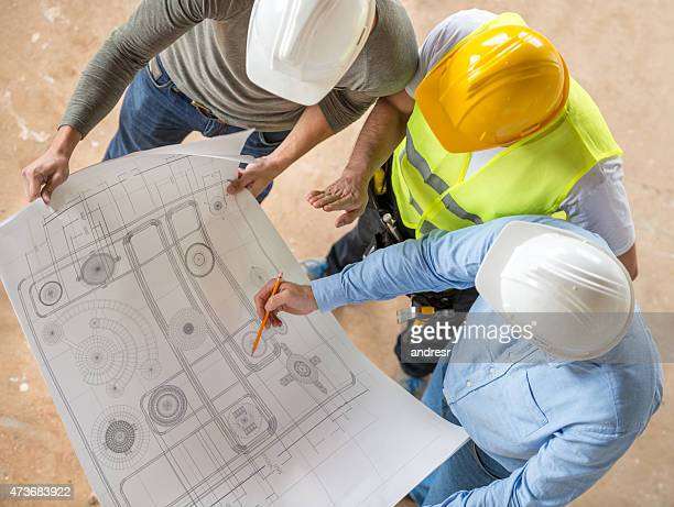 Civil engineers looking at blueprints