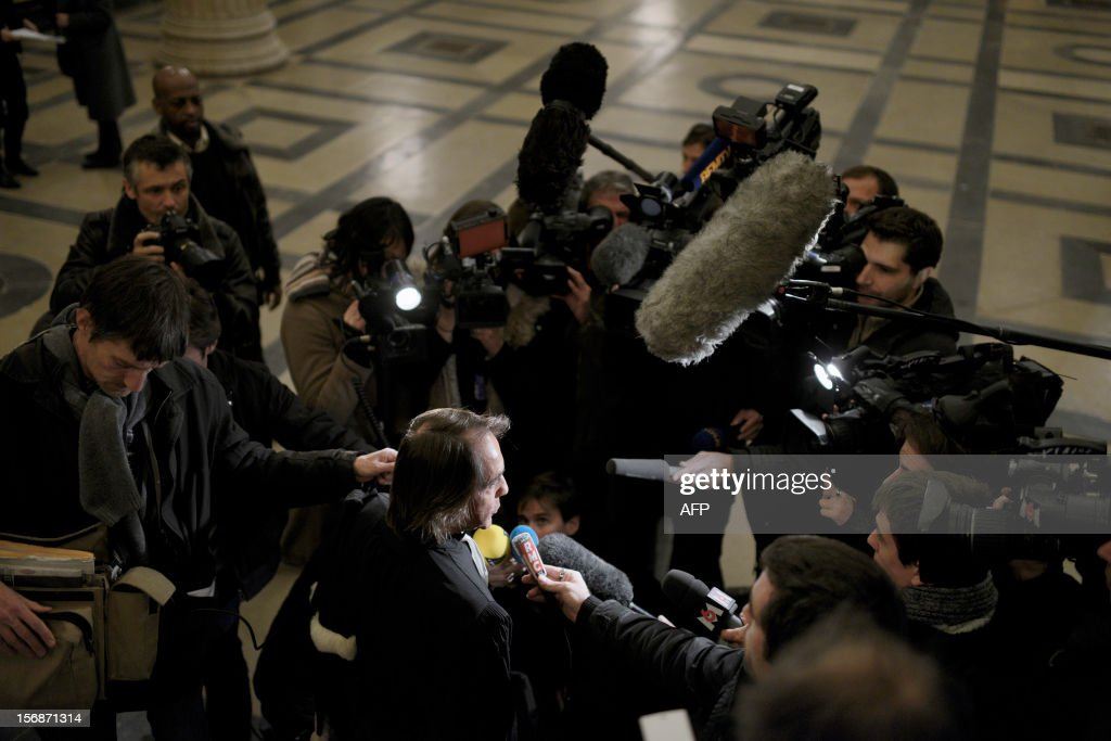 Civil party lawyer Jean-Claude Guidicelli speaks to journalists in front of the courtroom, on November 23, 2012, at the courthouse in Lyon, after Regis de Camaret, a former tennis coach was condemned to 8 years in jail for rape on two under-age women, 20 years ago.