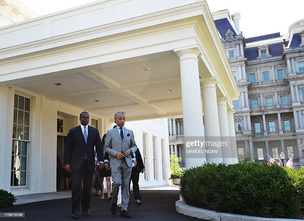 Civil rights activist Al Sharpton (R) and Atlanta Mayor Kasim Reed (L) make their way from the West Wing to speak to reporters after the two and a group of civil rights leaders met on the Voting Rights Act with US President Barack Obama, Attorney General Eric Holder and Labor Secretary Tom Perez on July 29, 2013 at the White House in Washington. AFP PHOTO/Mandel NGAN