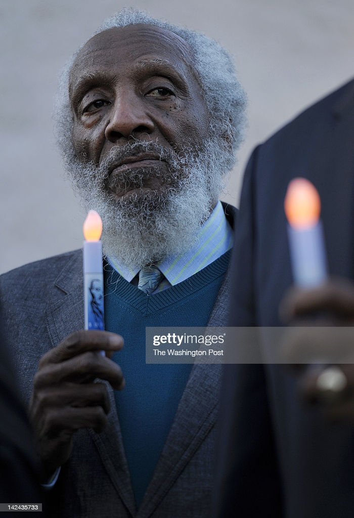 Civil rights activist Dick Gregory holds an artificial candle during a candlelight vigil at the Martin Luther King, Jr. National Memorial on April 4, 2012 in Washington, D.C. Several hundred folks gathered at the new memorial to honor the life and to mark the 44th anniversary of Martin Luther King's assassination in Memphis.