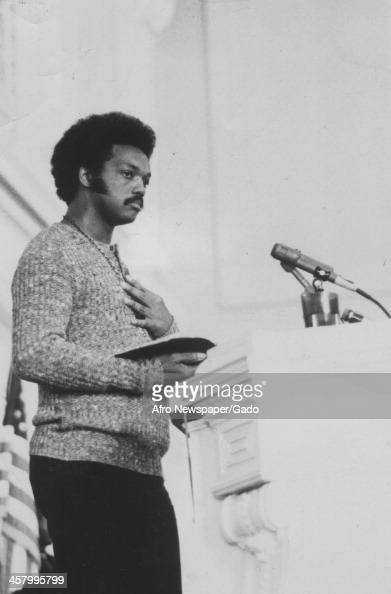 Civil rights activist Jesse Jackson Sr holds a bible and speaks with his hand on his heart 1960