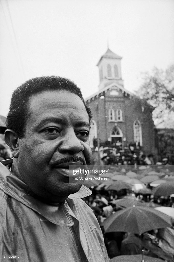 Civil rights activist Ralph Abernathy attends a rally in the rain at Dexter Avenue Baptist Church. The rally, held in the rain, commemorated Martin Luther King Jr. one year after his assassination.