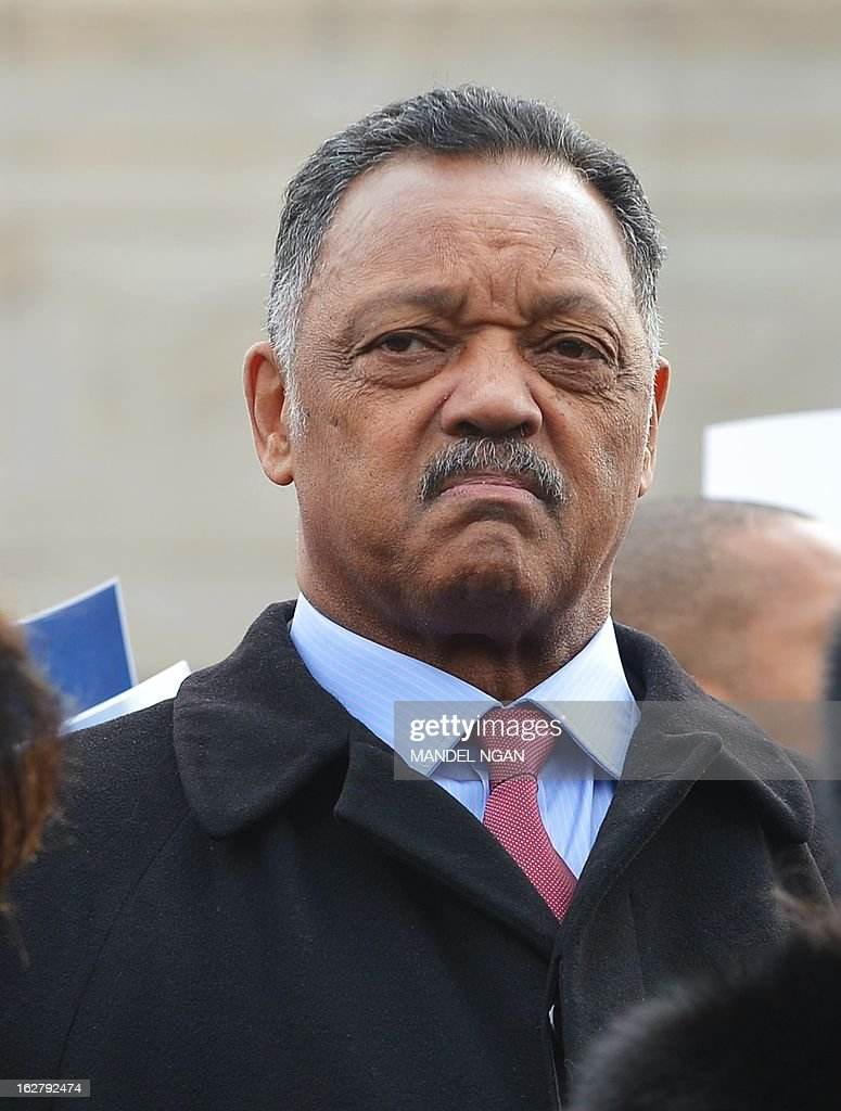 Civil rights activist, the Reverend Jesse Jackson listens to a speaker at a press conference infront of the US Supreme Court on February 27, 2013 in Washington, DC. The press conference was held as the Supreme Court prepared to hear Shelby County vs Holder. The case centers around a key section of the 1965 Voting Rights Act which mandates federal approval for any proposed voting changes in nine states. AFP PHOTO/Mandel NGAN