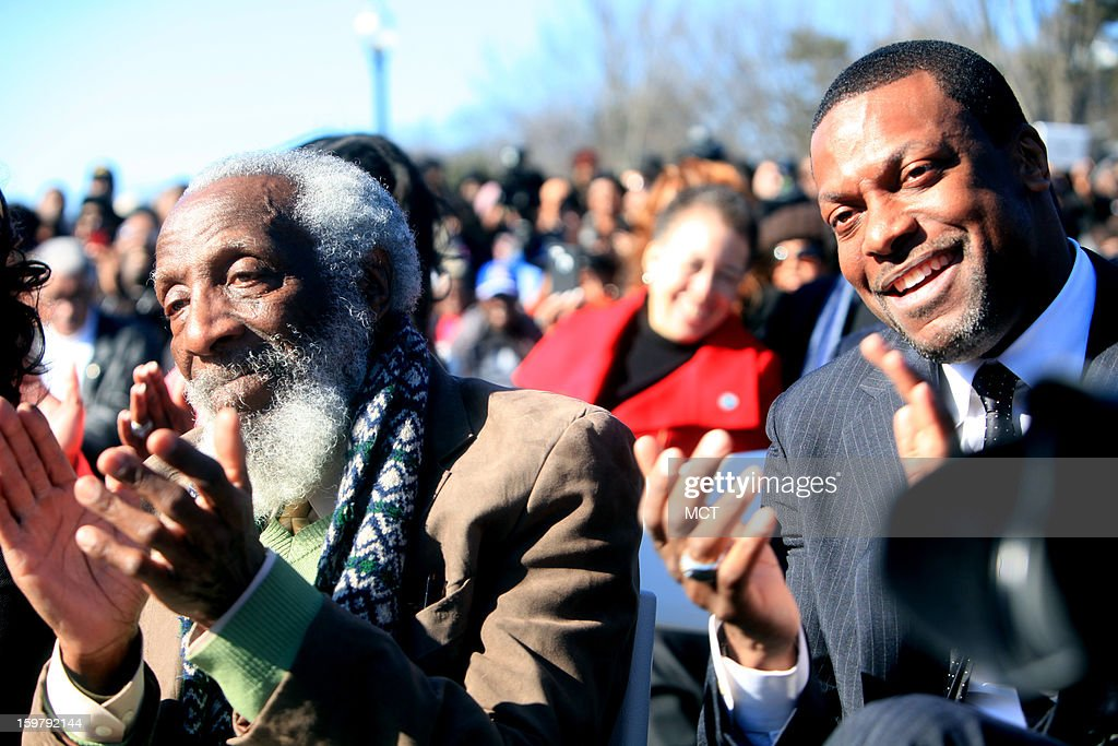 Civil rights activists Dick Gregory, left, and actor Chris Tucker celebrate Martin Luther King III's service during a wreath laying ceremony at the Martin Luther King Jr. National Monument on Sunday, January 20, 2013, in Washington, D.C. The tribute was made in honor of the Rev. Dr. Martin Luther King Jr., during festivities for the 57th Presidential Inauguration.