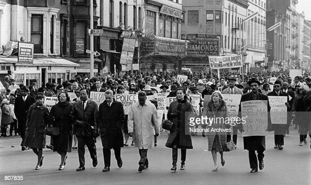 Civil rights advocates march in the Harlem section of New York to protest recent racial violence in Alabama March 16 1965