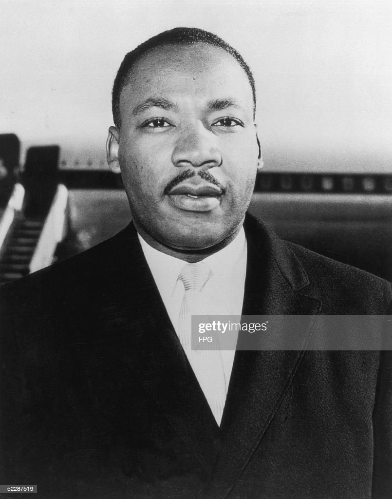 Civil rights campaigner <a gi-track='captionPersonalityLinkClicked' href=/galleries/search?phrase=Martin+Luther+King+Jr.&family=editorial&specificpeople=70030 ng-click='$event.stopPropagation()'>Martin Luther King Jr.</a> (1929 - 1968) at London Airport, 1961.