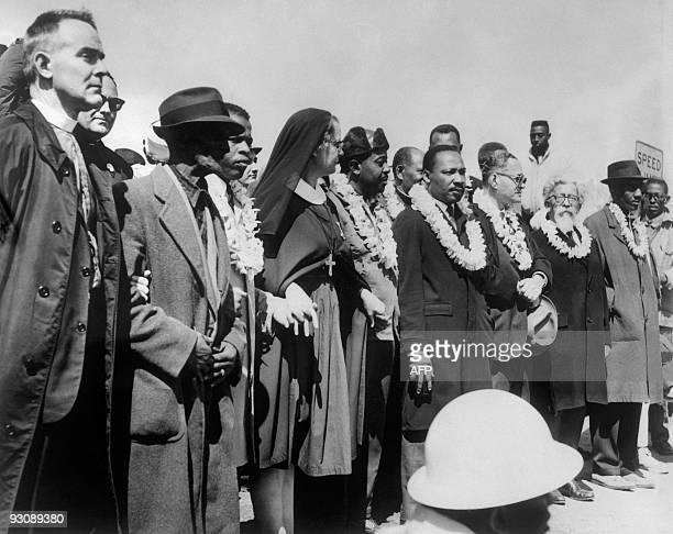 Civil rights demonstrators led by Dr Martin Luther King civil rights activist Ralph Abernathy John Lewis and other civil and religious leaders make...