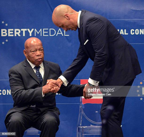 Civil Rights icon Rep John Lewis is greeted by host Byron Pitts as he arrives onstage to receive the 2016 Liberty Medal at the National Constitution...