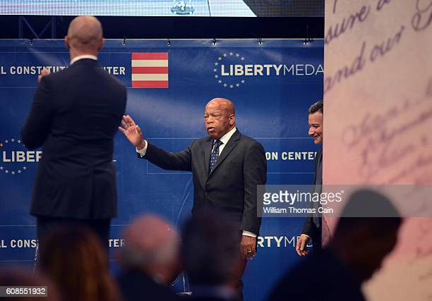 Civil Rights icon Rep John Lewis waves as he arrives onstage to receive the 2016 Liberty Medal at the National Constitution Center Monday September...