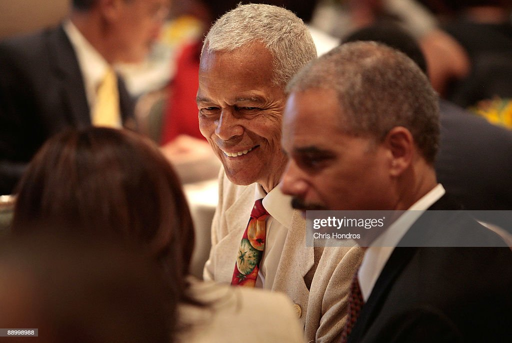 Civil rights leader and NAACP president <a gi-track='captionPersonalityLinkClicked' href=/galleries/search?phrase=Julian+Bond&family=editorial&specificpeople=221657 ng-click='$event.stopPropagation()'>Julian Bond</a> (C) and U.S. Attorney General <a gi-track='captionPersonalityLinkClicked' href=/galleries/search?phrase=Eric+Holder&family=editorial&specificpeople=1060367 ng-click='$event.stopPropagation()'>Eric Holder</a> (R) sit in the audience during the Clarence M. Mitchell Jr. Memorial Lecture Luncheon at the NAACP Centennial Convention July 13, 2009 in New York City. Holder later addressed the group of prominent black lawyers during the luncheon, part of the National Association for the Advancement of Colored People's 100th anniversary convention.