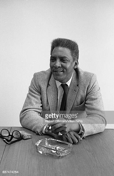 View of Civil Rights leader Bayard Rustin as he sits at a conference table New York 1964