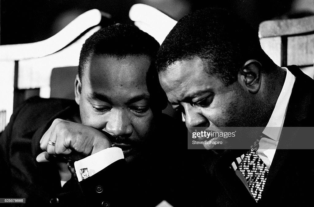 Civil rights leader Dr. Martin Luther King, Jr. speaks with Reverend Ralph Abernathy.