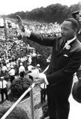 US civil rights leader Martin Luther KingJr waves to supporters 28 August 1963 from the Lincoln Memorial on the Mall in Washington DC during the...