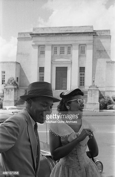 Civil rights leader Reverend Dr Martin Luther King Jrand his wife Coretta Scott King pose for a photo across the street from the Alabama Judicial...