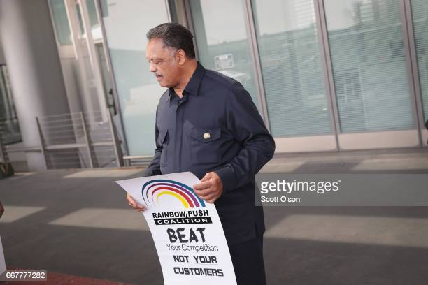 Civil rights leader Reverend Jesse Jackson arrives with a small group from the Rainbow PUSH Coalition for a protest outside the United Airlines...