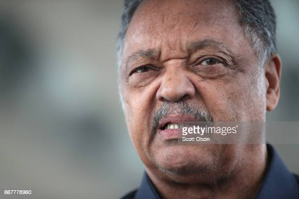 Civil rights leader Reverend Jesse Jackson leads a small group from the Rainbow PUSH Coalition in a protest outside the United Airlines terminal at...