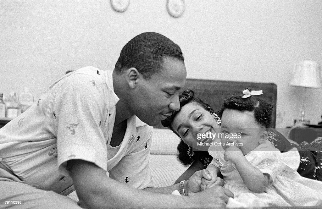 Civil rights leader Reverend Martin Luther King Jr relaxes at home with his wife Coretta and first child Yolanda in May 1956 in Montgomery Alabama