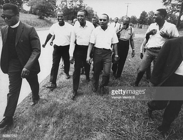 Civil rights leaders Floyd B McKissick Dr Martin Luther King Jr and Stokely Carmichael during march through Mississippi to encourage voter...