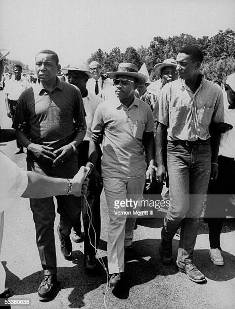 Civil rights leaders Floyd B McKissick Dr Martin Luther King Jr and Stokely Carmichael marching through Mississippi to encourage voter registration