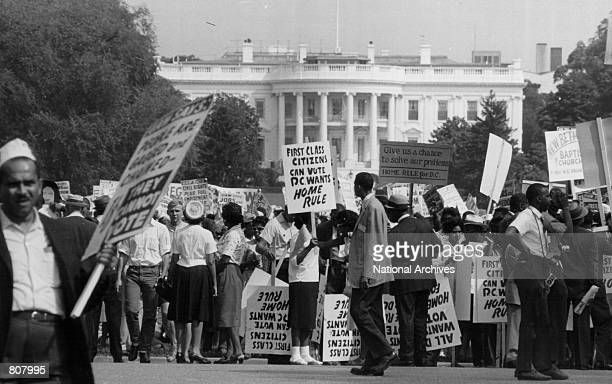 Civil rights marchers protest in front of the White House for District of Columbia Home Rule in April of 1965