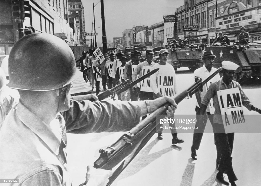 30th March 1968, Memphis, Tennessee, Guardsmen with fixed bayonets in Beale Street, Memphis as black marchers stage a protest march