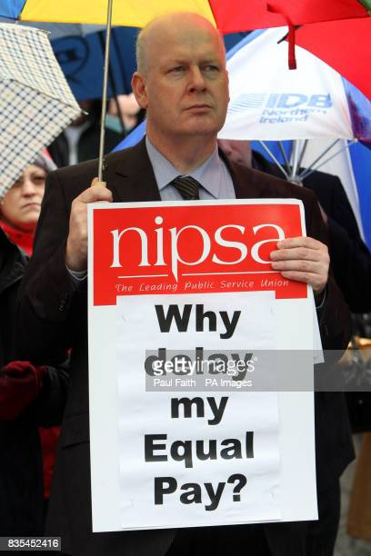 A civil servant staging a protest over the delay in implementing an equal pay deal promised last year by ministers outside the City Hall and at...