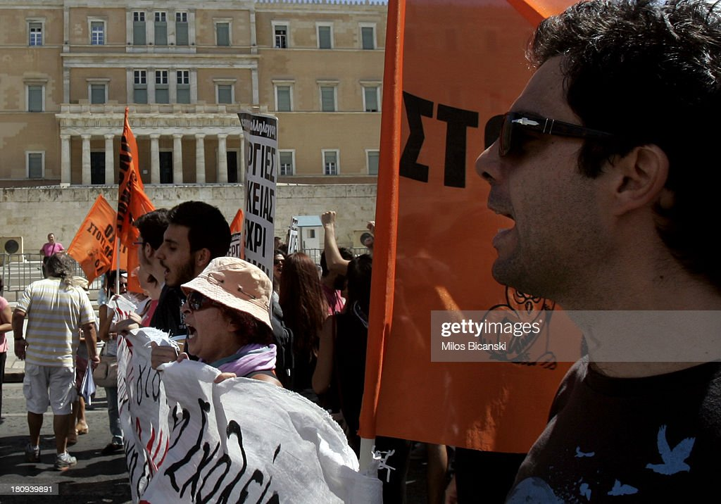 Civil servants protest with banners in front of the Greek Parlament building during a demonstration against austerity and job cuts on September 18, 2013 in Athens, Greece. As part of the redeployment plan in the country reeling from six years of recession, civil servants have to accept new posts or spend eight months on reduced salaries as alternative posts are found, with the risk of losing their jobs altogether.