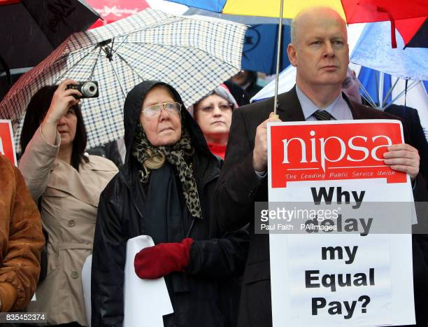 Civil servants staging a protest over the delay in implementing an equal pay deal promised last year by ministers outside the City Hall and at...