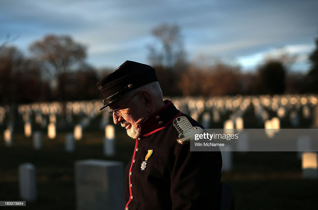 Civil War enthusiast Andrew Johnson walks through Arlington National Cemetery following a burial service for two unknown sailors who were killed in 1862 when the Civil War era USS Monitor sank off the coast of North Carolina March 8, 2013 in Arlington, Virgiina. The sailors' remains, recovered when a portion of the ship was raised eleven years ago, were buried with full military honors.