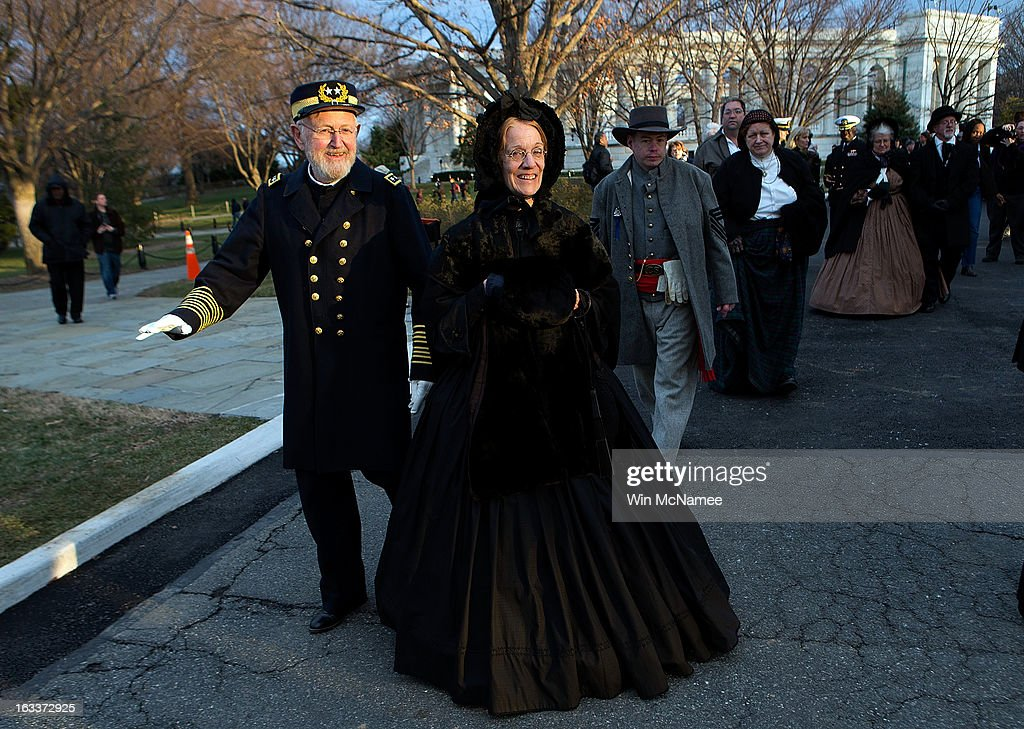 Civil War enthusiasts, including Sam Caldwell (L), depart following a funeral service at Arlington National Cemetery for two unknown sailors who were killed in 1862 when the Civil War era USS Monitor sank off the coast of North Carolina March 8, 2013 in Arlington, Virgiina. The sailors' remains, recovered when a portion of the ship was raised eleven years ago, were buried with full military honors.
