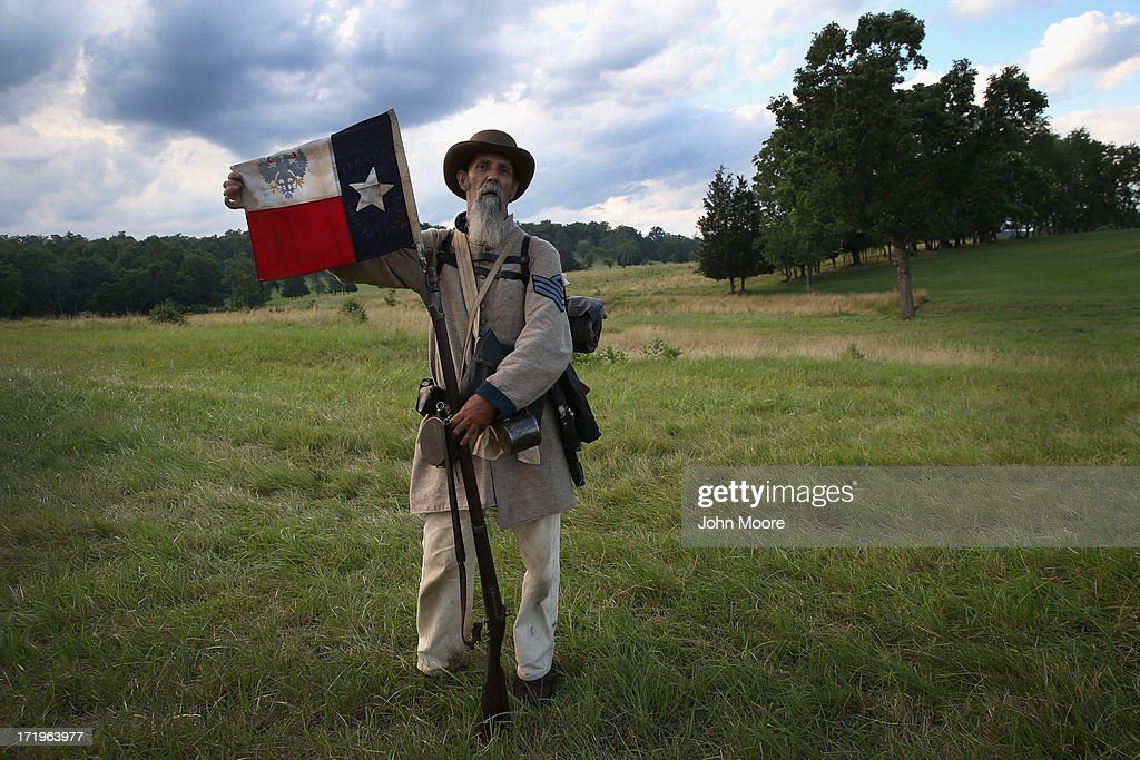 Civil War re-enactor Randy Whitaker from Hood's Texas Brigade displays the Texas flag during a three-day Battle of Gettysburg re-enactment on June 29, 2013 in Gettysburg, Pennsylvania. Some 8,000 re-enactors from around the United States are participating in events marking the 150th anniversary of the July 1-3, 1863 Battle of Gettysburg. General Robert E. Lee's Army of Northern Virginia was defeated on the third day of the battle, considered the turning point in the American Civil War and a watershed moment in the nation's history. Union and Confederate armies suffered a combined total of some 46,000-51,000 casualties over three days, the highest of any battle the four-year war.