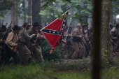 Civil War reenactors from Hood's Texas Brigade launch an evening attack as part of a threeday Battle of Gettysburg reenactment on June 29 2013 in...