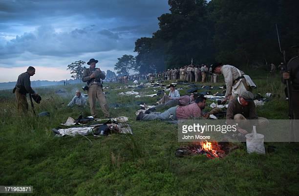 Civil War reenactors from Hood's Texas Brigade rest in camp during a threeday Battle of Gettysburg reenactment on June 29 2013 in Gettysburg...