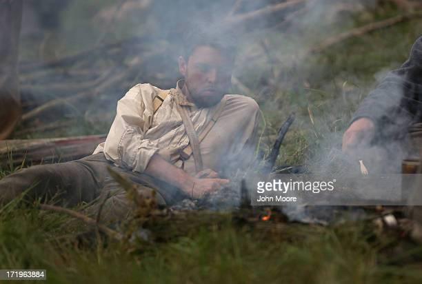 Civil War reenactors prepare a meal during a threeday Battle of Gettysburg reenactment on June 29 2013 in Gettysburg Pennsylvania Some 8000...
