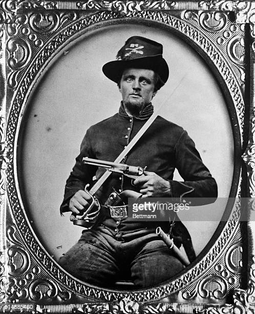 Union Cavalry Private Well equipped with a pair of Colt Model 1861 Navy revolvers and saber holster cap pouch and saber scabbard Photograph