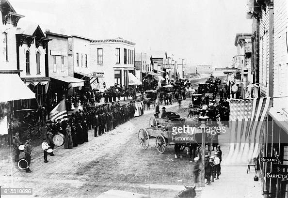 Civil War veterans on Fourth of July or Decoration Day on review on the main street of Ortonville Minnesota ca 1880