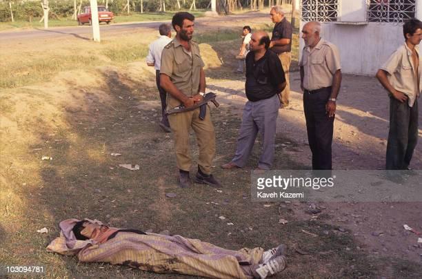 A civilian casualty of the NagornoKarabakh conflict between Armenia and Azerbaijan lies dead by the roadside in Imishli Azerbaijan 23rd August 1993
